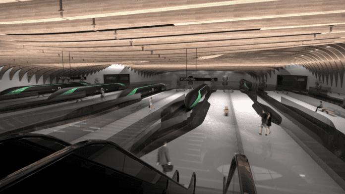 A hyperloop station mock-up showing hyperloops on platforms in a futuristic station