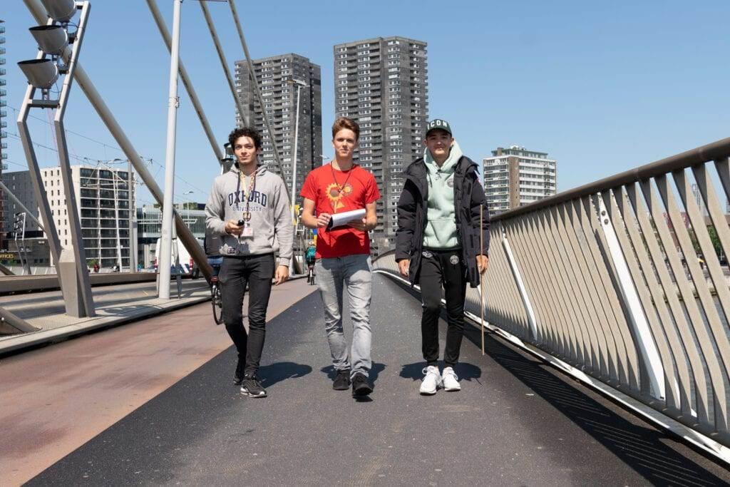 Photo-of-three-male-students-from-Rotterdam-International-Secondary-School-crossing-Erasmus-Bridge-Rotterdam
