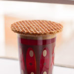 How_to_eat_a_stroopwafel_(8557345379)