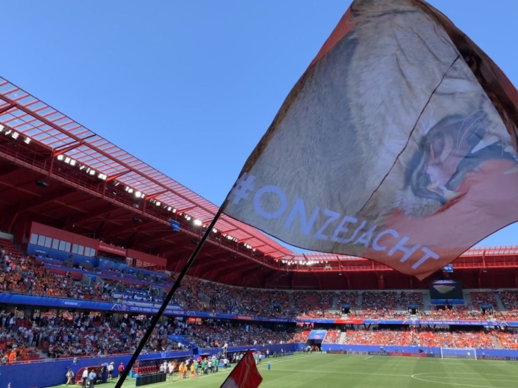 A flag with a lioness on it is waved in the Valencienne's, France, stadium for a Netherlands match in the 2019 FIFA Womens World Cup.