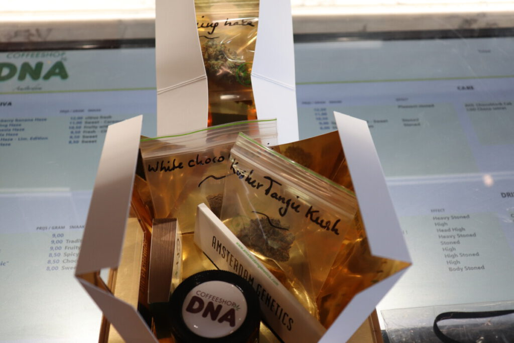 photo of gift box of weed, hash, grinder, and papers at DNA Coffeeshop Amsterdam
