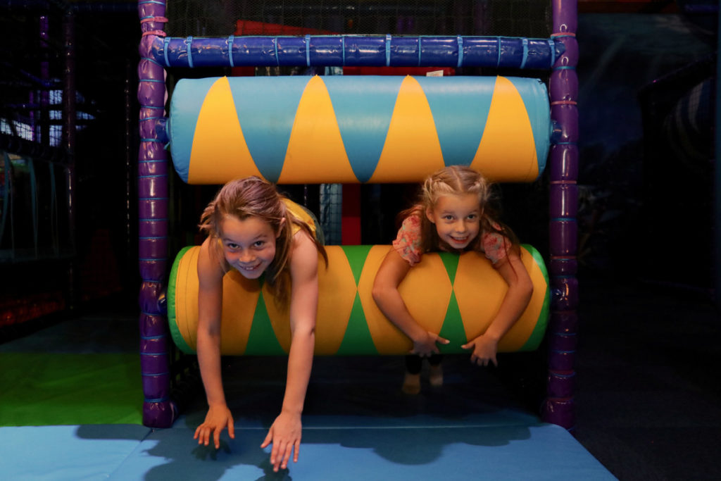 children-playing-on-foam-rollers