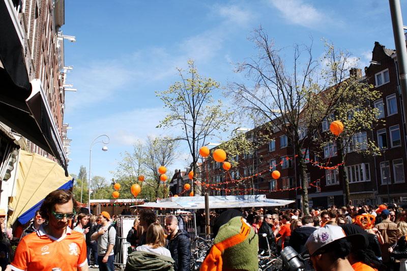 People celebrating King's Day in Amsterdam.