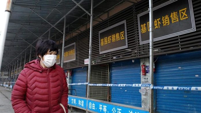 a man walking with a face mask against coronavirus
