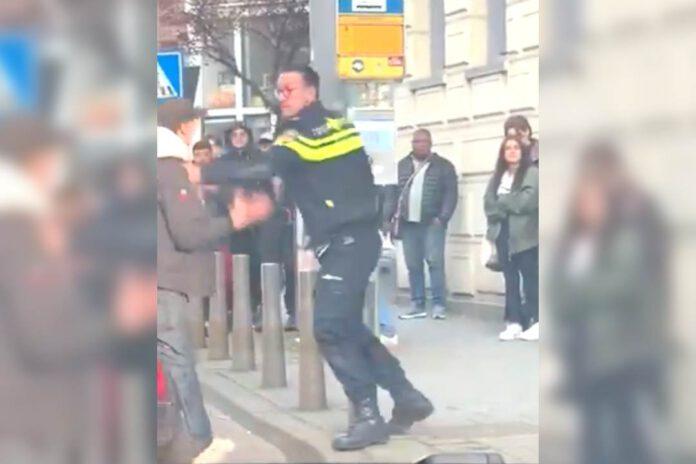photo-of-rotterdam-police-officer-hitting-boy