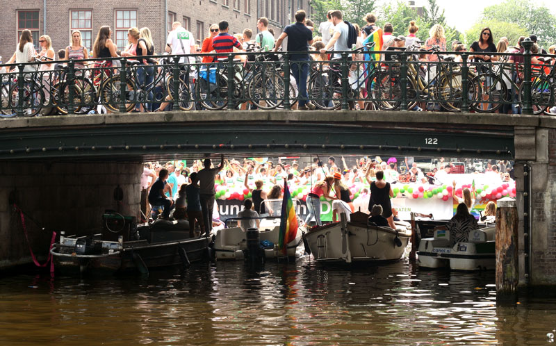 People on a canal at Pride Parade in Amsterdam.