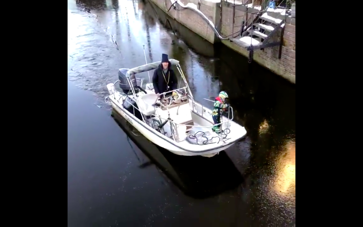 Man-drives-skipper-on-icey-canal