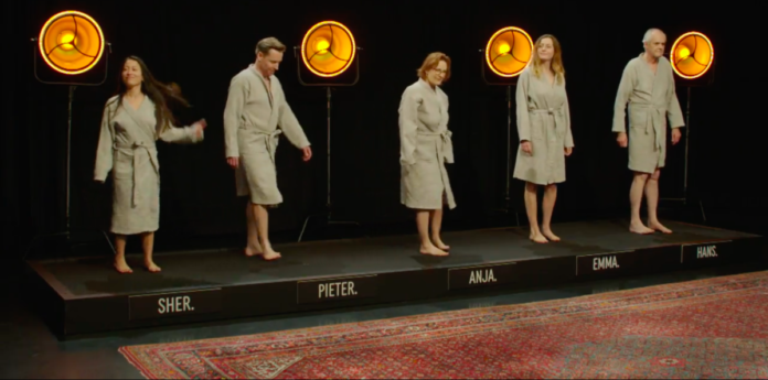 Dutch-men-and-women-standing-on-a-stage-in-bathrobes