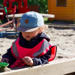 kids sandbox playing