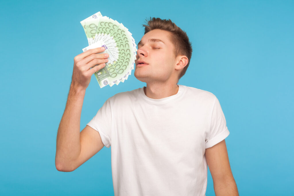 Greedy-landlord-fanning-himself-with-money
