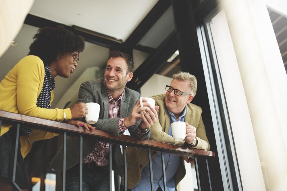 photo-group-of-Dutch-colleagues-taking-a-coffee-break-and-talking