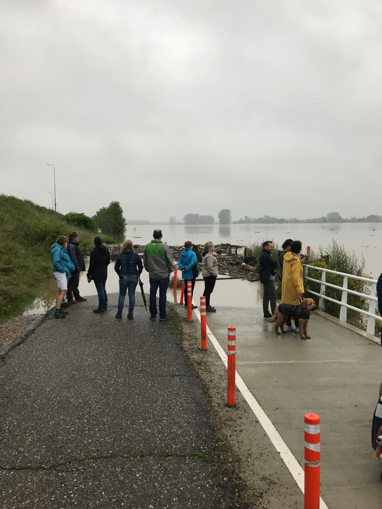 Flooding-in-Limburg-crowds-gather-in-Elsloo-village-to-look-at-what-was-a-field