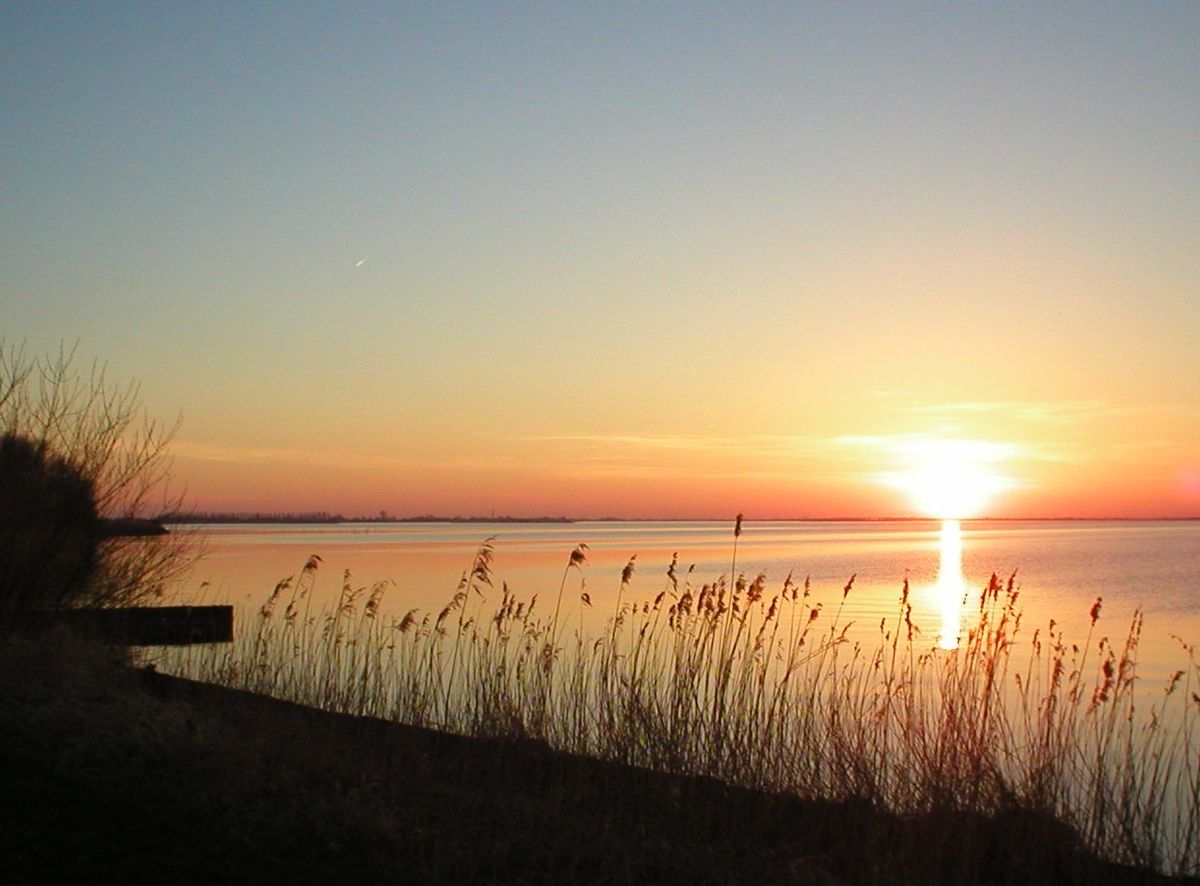 The sun sets over Tjeukemeer, a popular Dutch lake .