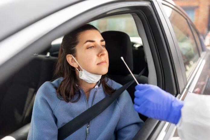 Woman-in-a-car-having-a-coronavirus-PCR-test
