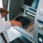 Woman pressing key pin code holding wallet