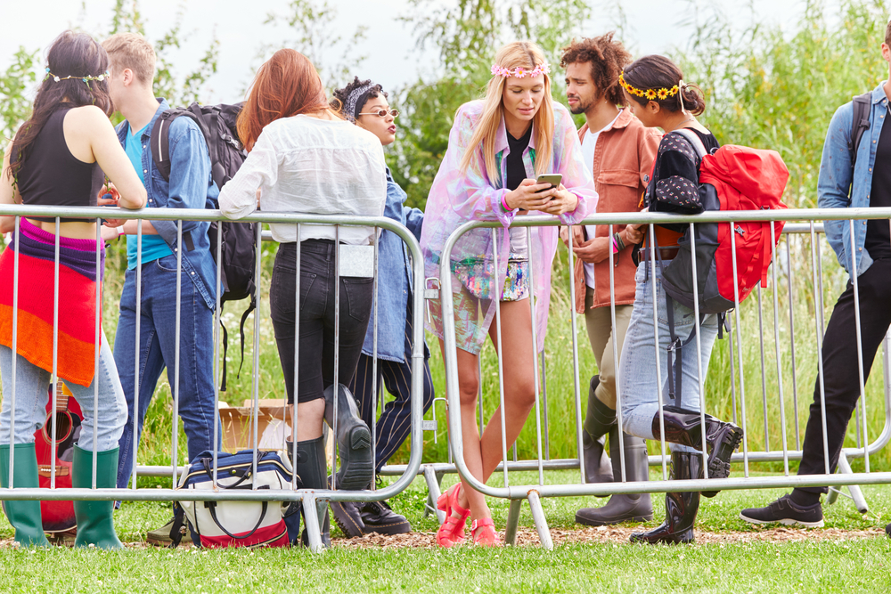 picture-of-a-group-of-people-waiting-in-line-at-musical-event