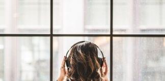girl-wears-headphones-in-front-of-window