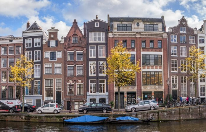 photo-of-houses-on-amsterdam-canal