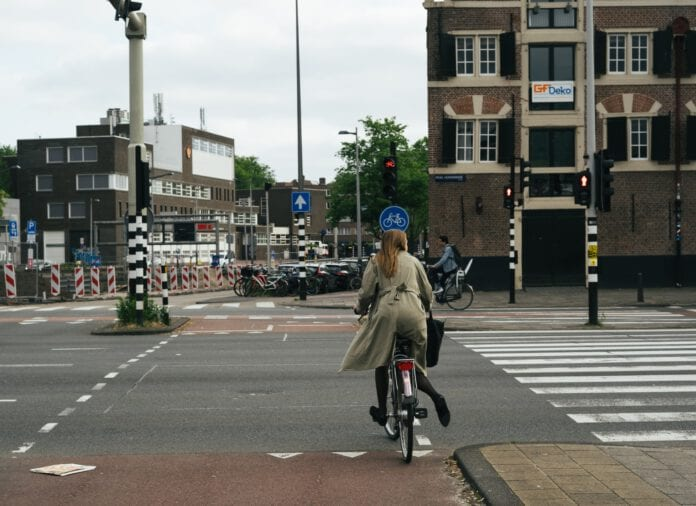 photo-of-a-girl-cycling-in-the-netherlands