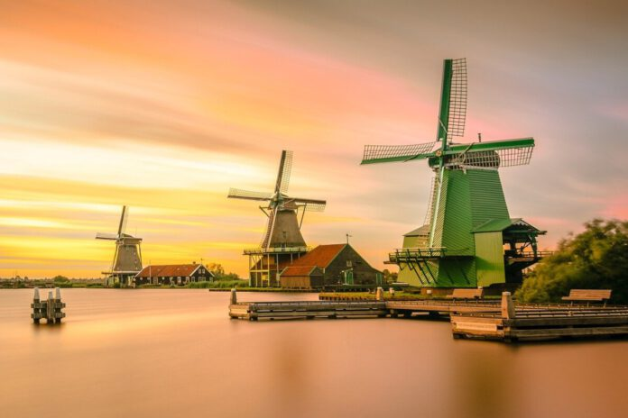 photo-of-zaanse-schans-windmills-sunset