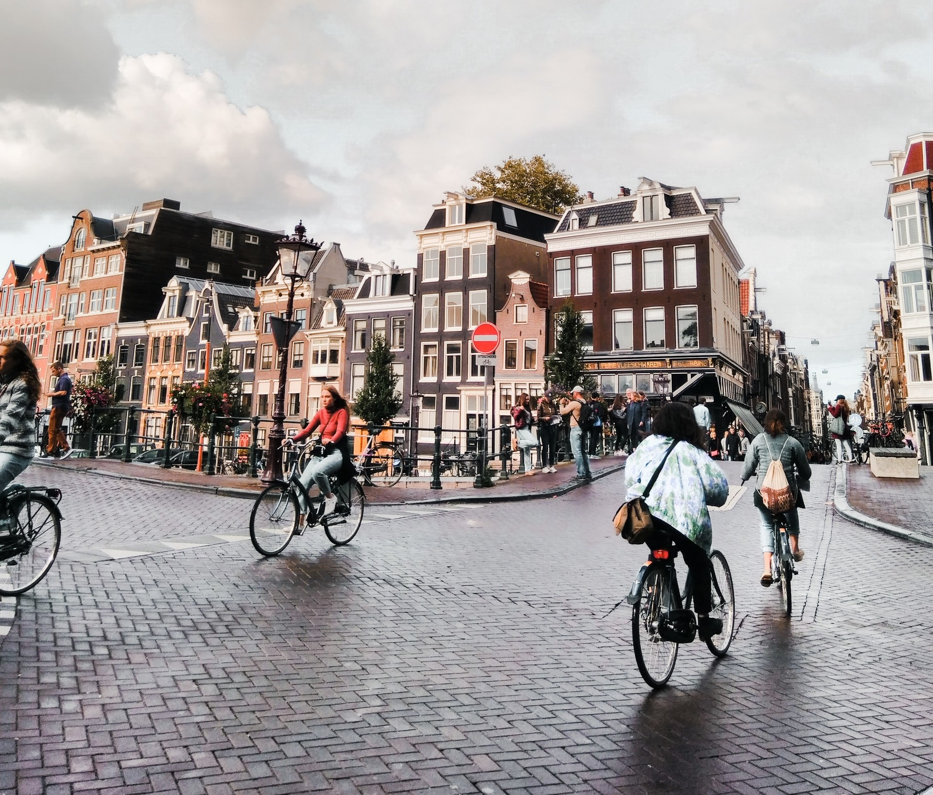 photo-of-a-couple-cycling-on-a-dutch-bicycle-lane