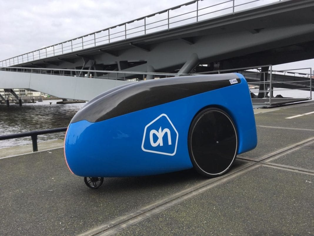 A delivery robot used by Albert Heijn on a Dutch road