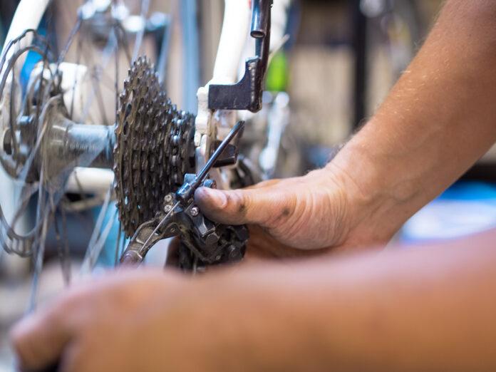 repairman fixing bike