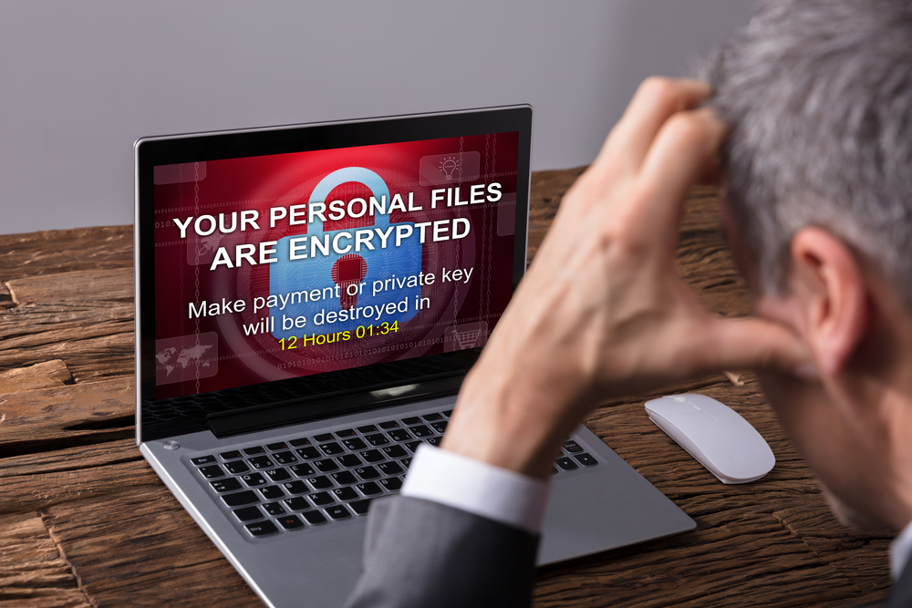 a-picture-of-a-businessperson-with-laptop-under-cyberattack