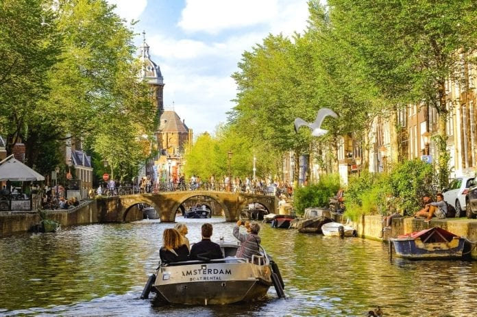 picture of boat in canal in amsterdam