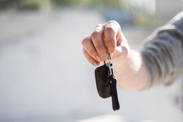 man holding car keys in the netherlands