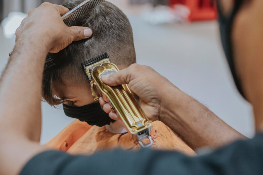 person-wearing-a-mask-getting-a-haircut-in-the-netherlands