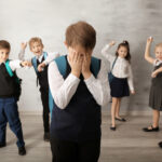 Children bullying their classmate indoors