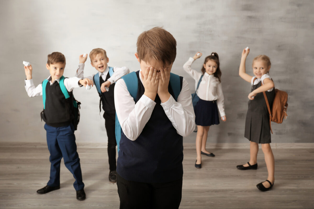 stressed-child-being-bullied-by-classmates