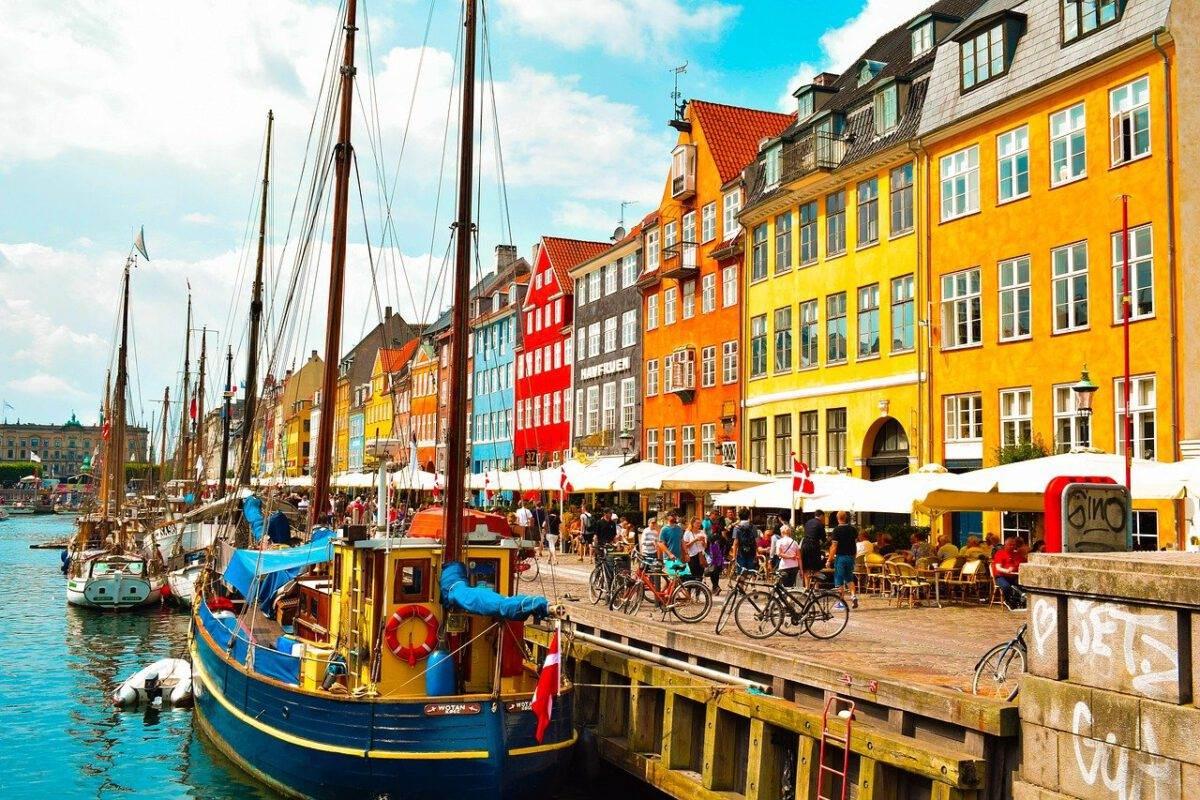 People enjoying summer holidays at cafe in Copenhagen