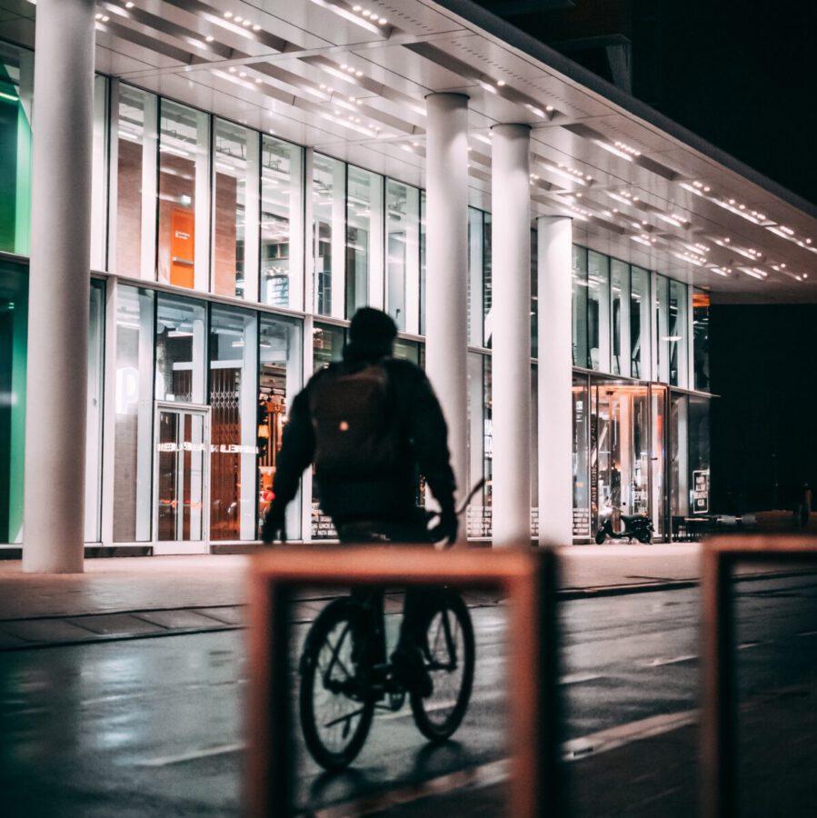 Dutch-man-riding-an-electric-bike-in-Rotterdam-at-night