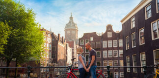 photo-of-couple-living-in-amsterdam-standing-on-bridge