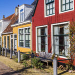 Colorful facades of old houses in Harlingen