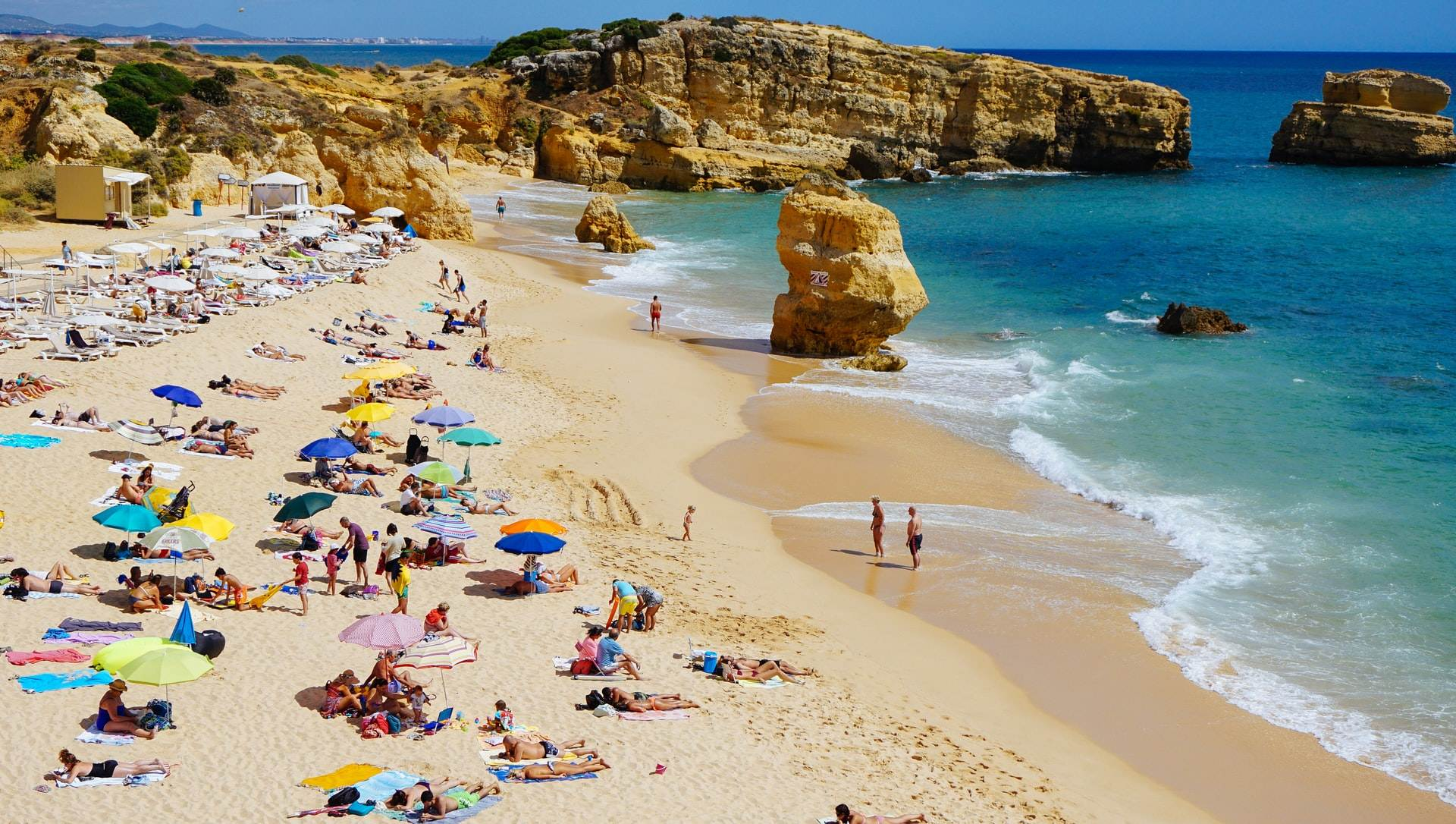 photo-of-peope-on-holiday-on-a-portuguese-beach