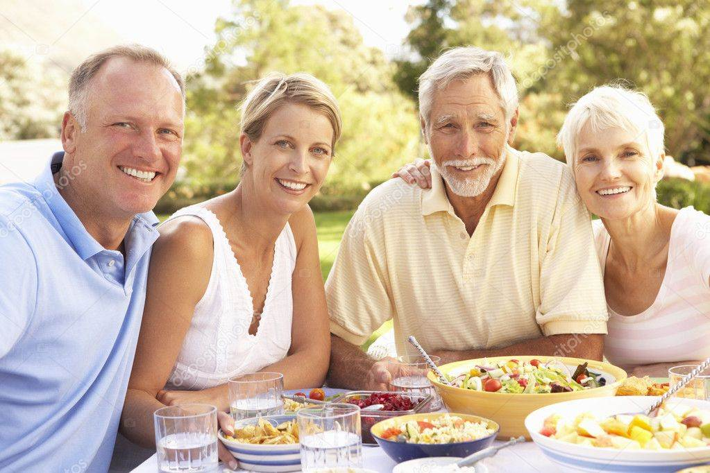 Dutch-family-having-dinner-together-outside-parents-and-daughter