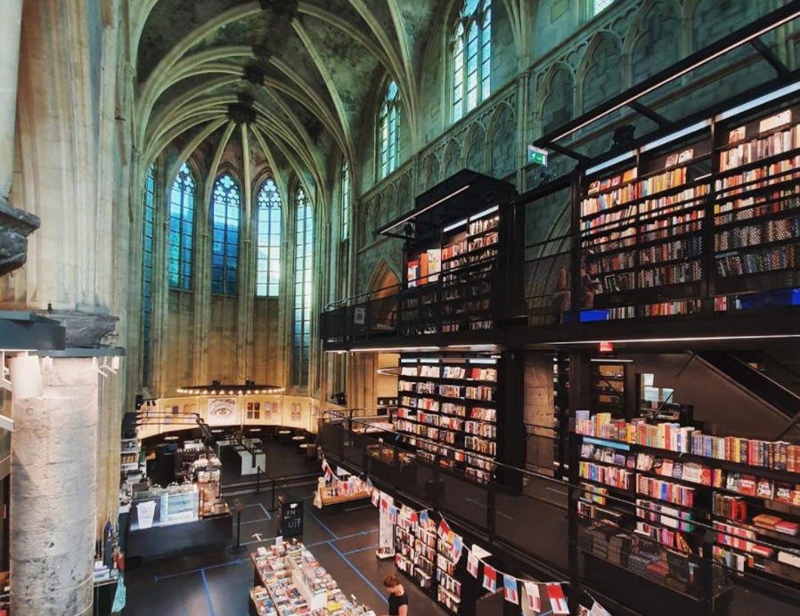 dominicanen-book-store-with-shelves-of-books-reaching-up-the-walls-of-the-church