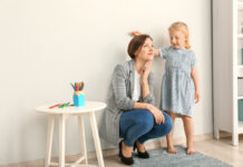 daughter-measuring-the-height-of-her-mom