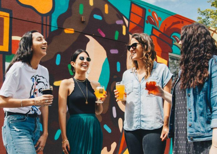photo-of-four-friends-drinking-beer-outside