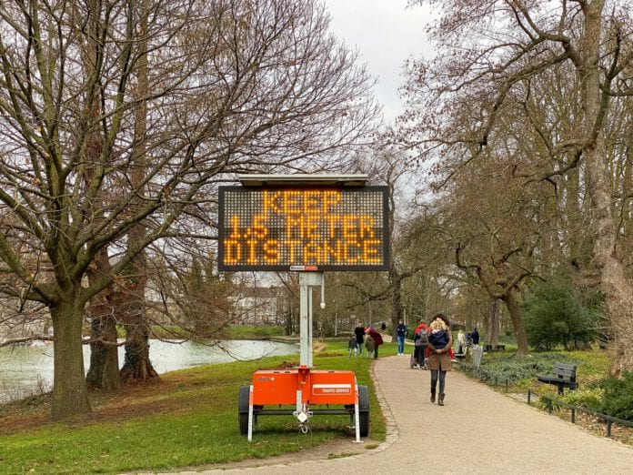 photo-of-a-keep-one-point-five-meter-distance-sign-in-a-park-in-maastricht