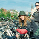 Two women locking bikes in Amsterdam