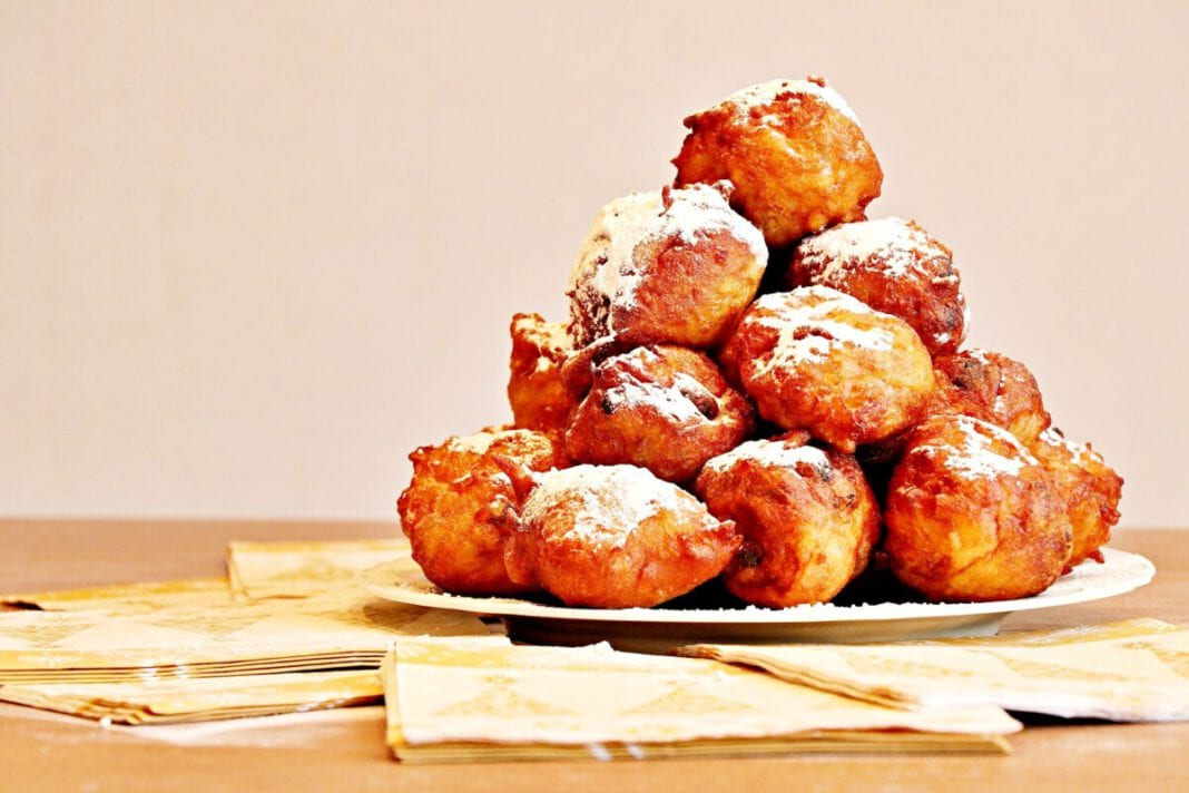 photo-of-dutch-oliebollen-stacked-on-plate