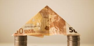 photo-of-bank-note-on-coins-making-rental-house-deposit