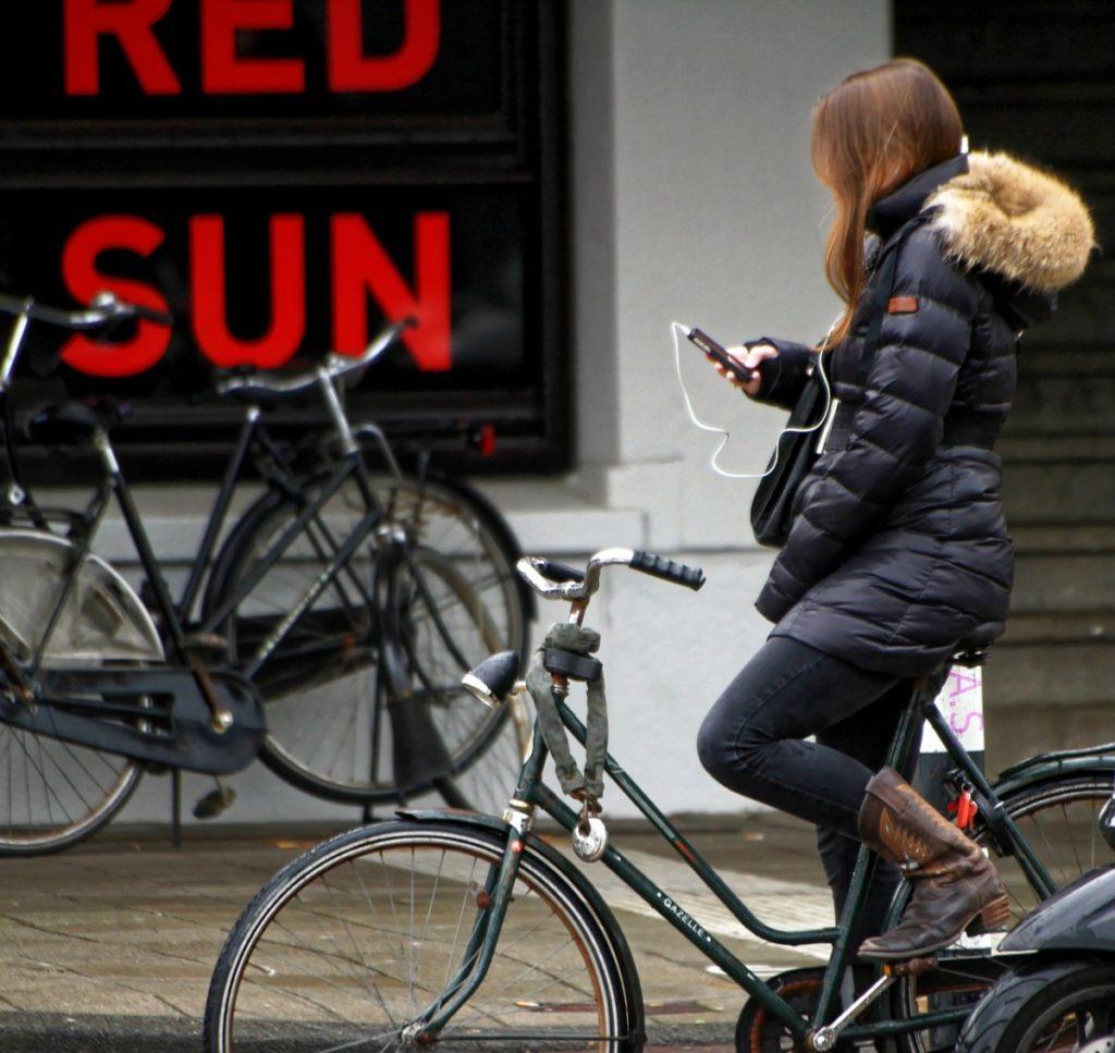 Girl on bike using phone