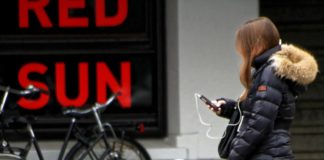 Girl on bike using phone