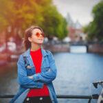 Girl in sunglasses on bridge in Amsterdam