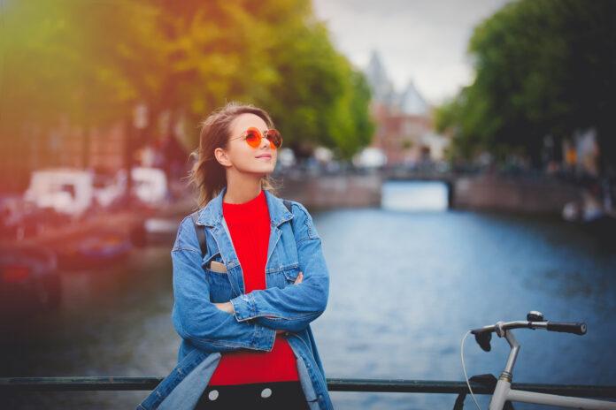 girl-wearing-sunglasses-on-bridge-in-amsterdam-in-autumn